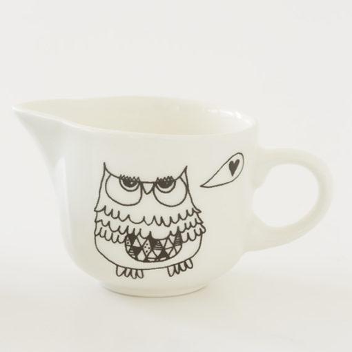 Ceramic milk jug with owl illustration