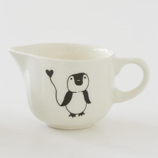 Ceramic milk jug with penguin illustration