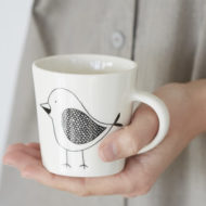 Ceramic coffee cup with bird
